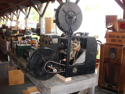 Old movie projector $75-, I bought the little deco Howard receiver right behind it a few minutes later