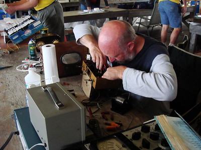 Peter Wieck at the club table doing a repair demo