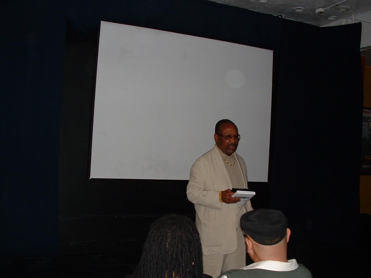 Back inside the gathering Dr. Kwaku kicks off the films on Dr. John Henrik Clarke shown that evening.