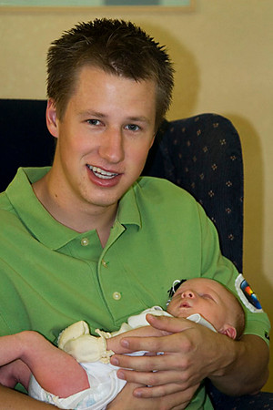 New Uncle Mark with little Kyle during his first week of life.