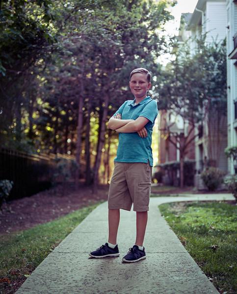 Walking the apartment complex. Fairfax, Virginia. July 2019. PORTRA medium format.