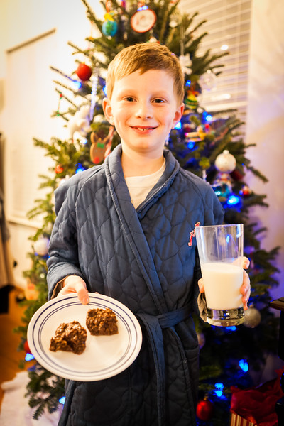 Putting cookies and milk out for Santa.