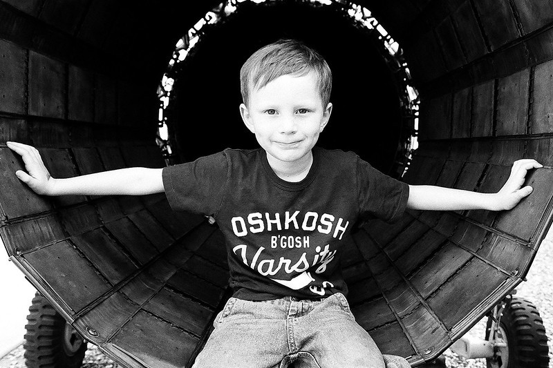 Kyle sitting in an aircraft engine. Taken with Ilford Delta 400. Mar 2013.