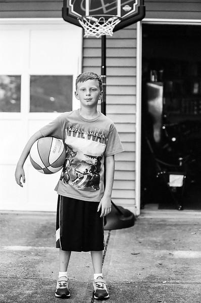 Looking hard on the court! Aug 2016. Kodak Tri-X.