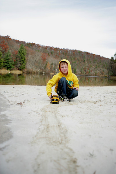 "Kyle ""mining"" on the beach at Trout Pond Recreation Area, West Virginia."