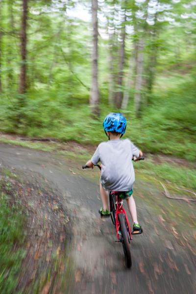 Nothing like riding behind him at a full clip and running the SLR. July 2015. Herndon, VA. Digital.