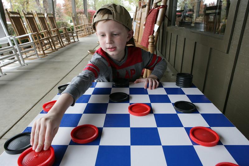Playing checkers at Cracker Barrel before our Halloween adventure starts. Manassas, VA. 2013