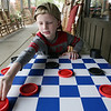 Playing checkers at Cracker Barrel before our Halloween adventure starts. Manassas, VA. 2013