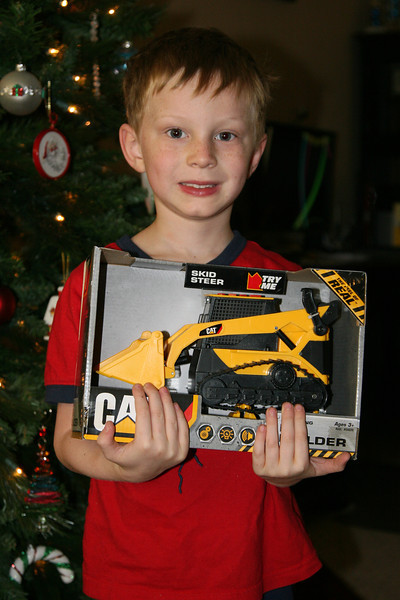 Kyle after he opened his prized skid steer construction truck (2012).
