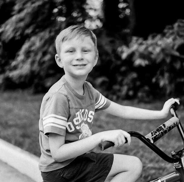 A couple days after learning to ride his bike. Yashica TLR, Tri-X medium format film