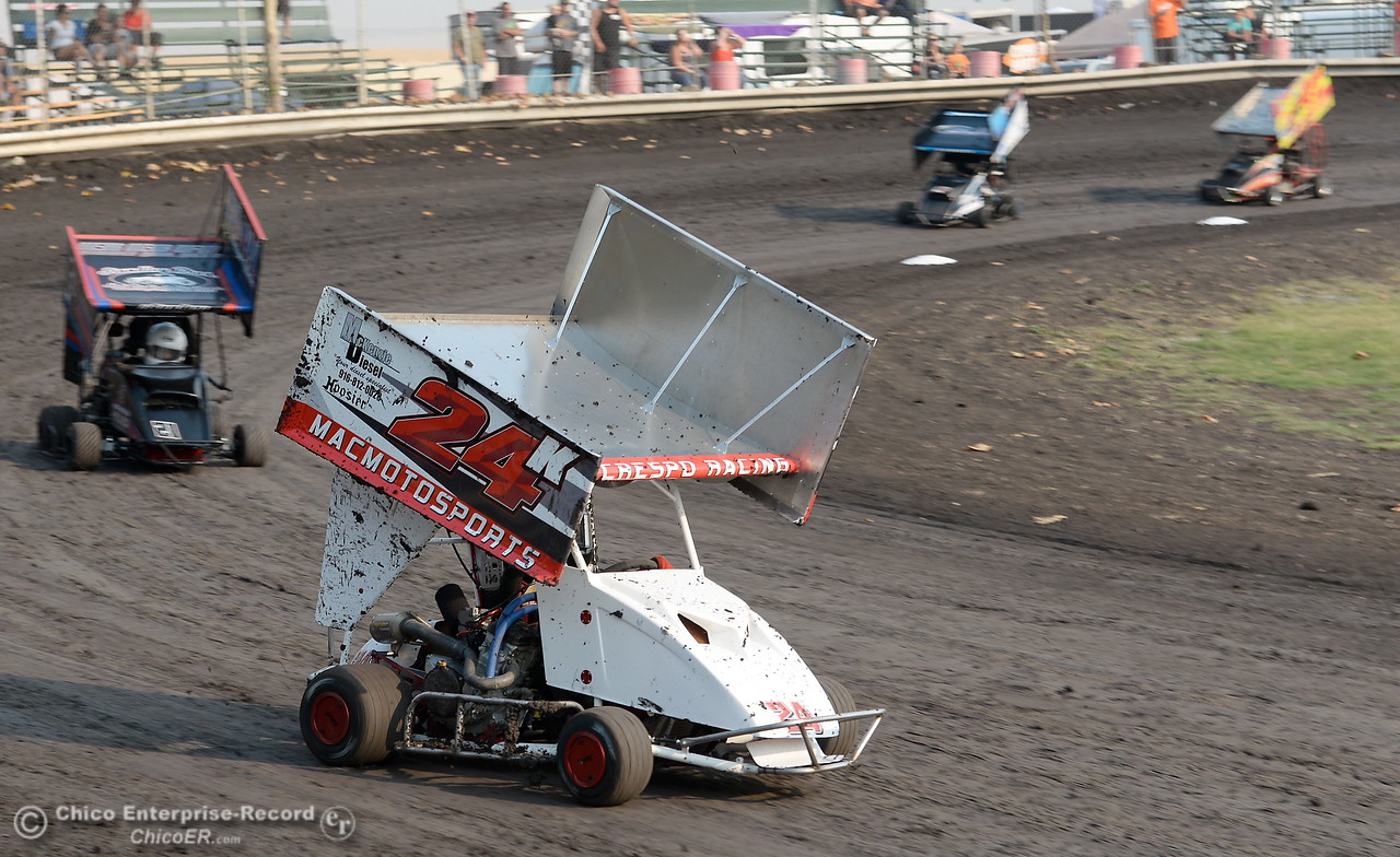 Sean Knox leads a pack through the corner in the 21k kart during the Third Annual Kyle Larson Outlaw Kart Showcase at Cycleland Speedway Monday Sept. 4, 2017. (Bill Husa -- Enterprise-Record)