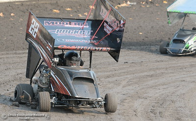 Carly Holmes #22c lifts a wheel off the ground in the corner during the Third Annual Kyle Larson Outlaw Kart Showcase at Cycleland Speedway Monday Sept. 4, 2017. (Bill Husa -- Enterprise-Record)