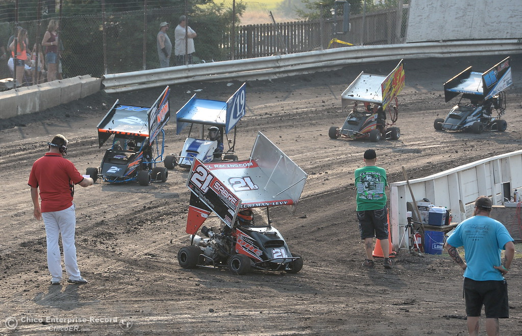 . Racers follow instructions on the track during the Third Annual Kyle Larson Outlaw Kart Showcase at Cycleland Speedway Monday Sept. 4, 2017. (Bill Husa -- Enterprise-Record)