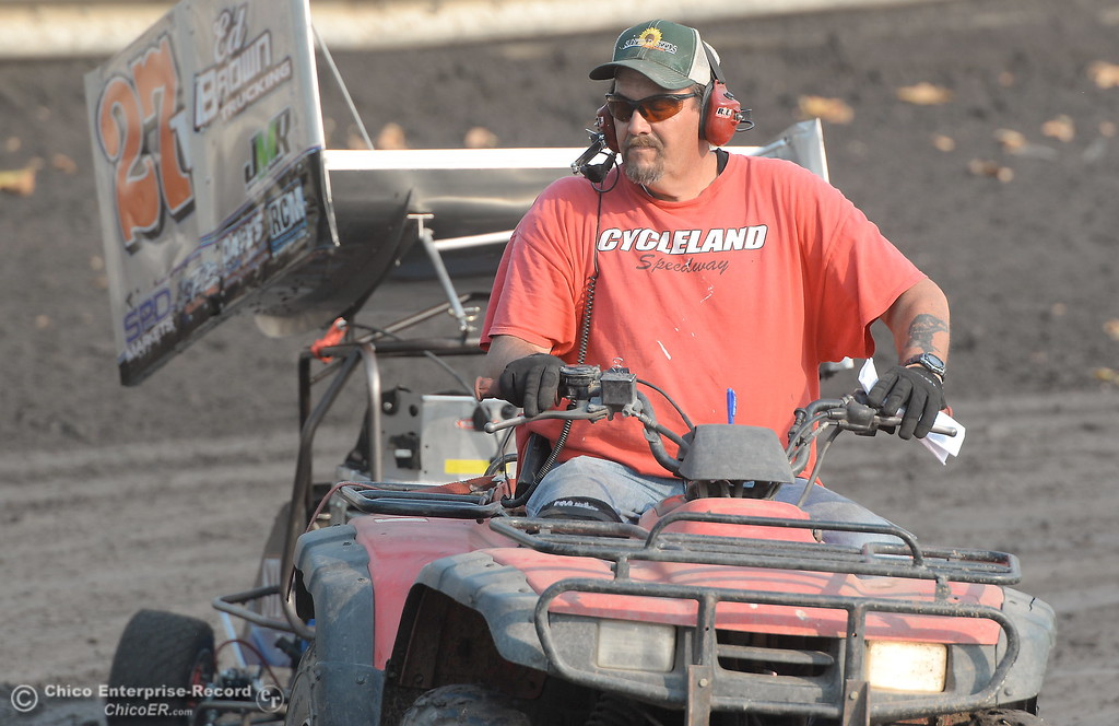 . A Cycleland pushcart driver helps out a racer during the Third Annual Kyle Larson Outlaw Kart Showcase at Cycleland Speedway Monday Sept. 4, 2017. (Bill Husa -- Enterprise-Record)