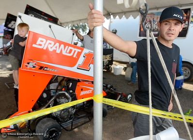 While son Owen climbs on his kart, Kyle Larson talks about the Kyle Larson Outlaw Kart Showcase during an interview at Cycleland Speedway in Oroville, Calif. Tues. Sept. 4, 2018.  (Bill Husa -- Enterprise-Record)