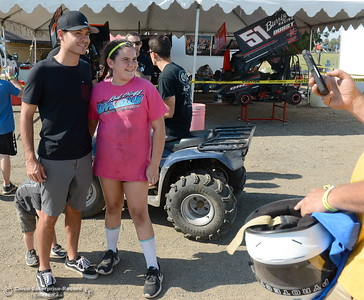 Kyle Larson smiles after giving an autograph to 10-year-old Jiliana Vieira of Yuba City during the Kyle Larson Outlaw Kart Showcase at Cycleland Speedway in Oroville, Calif. Tues. Sept. 4, 2018.  (Bill Husa -- Enterprise-Record)