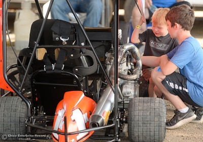 Owen Larson and another unidentified young man at right check out Kyle's Kart during the Kyle Larson Outlaw Kart Showcase at Cycleland Speedway in Oroville, Calif. Tues. Sept. 4, 2018.  (Bill Husa -- Enterprise-Record)