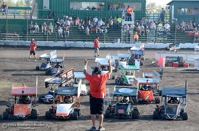 Racers line up in the middle of the track during hot laps during the Kyle Larson Outlaw Kart Showcase at Cycleland Speedway in Oroville, Calif. Tues. Sept. 4, 2018.  (Bill Husa -- Enterprise-Record)