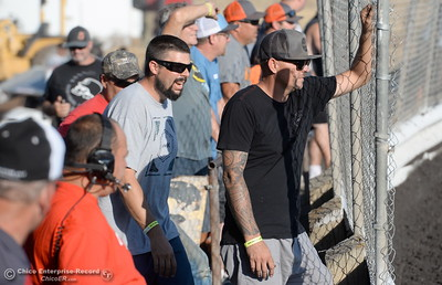 Dads and mechanics watch from the fence during the Kyle Larson Outlaw Kart Showcase at Cycleland Speedway in Oroville, Calif. Tues. Sept. 4, 2018.  (Bill Husa -- Enterprise-Record)