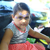 Jazzmyle Nieves with her face painted .