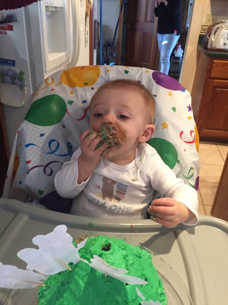 He's loving the cake now!