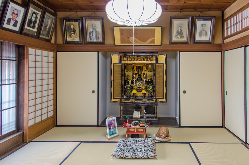 Photos of ancestors line the walls of the Nakamura Tokichi Honten in Uji, Japan