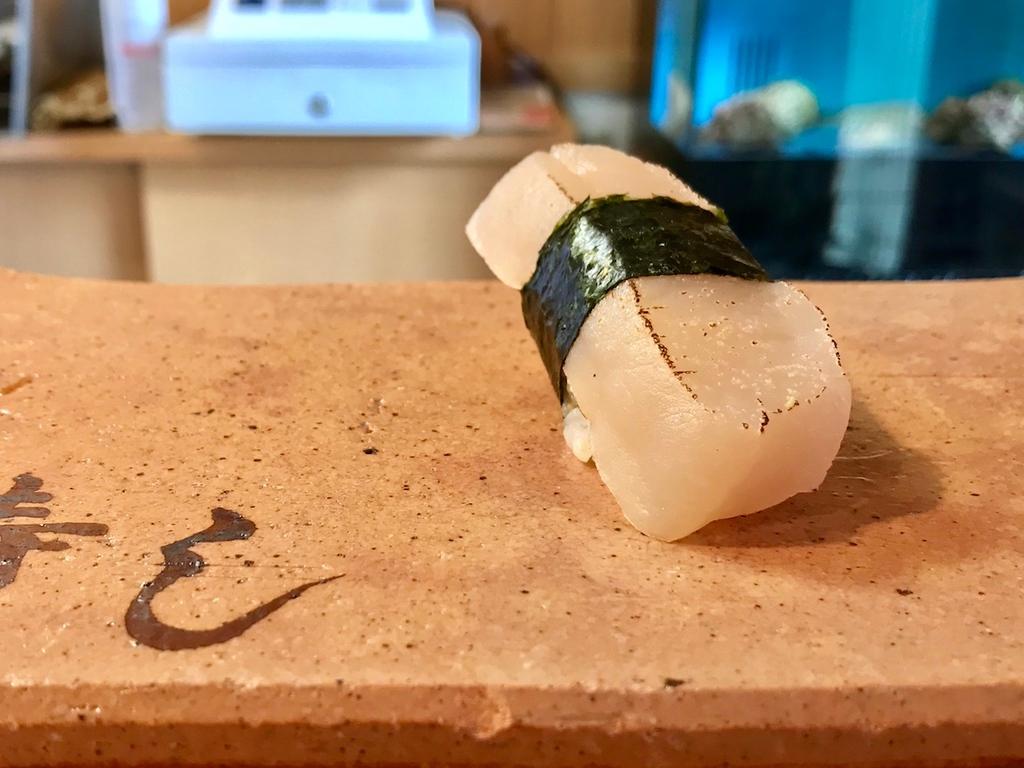 Taihiragi, wrapped with a band of nori seaweed – a meaty texture, much like a firm, chunky scallop.