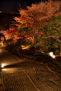 Zen Garden at Chion-in Monastery in Kyoto with Autumn Foliage  Illuminated raked Gravel at Night
