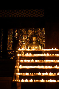 Candles in Front of a Buddha Statue  At Night in Kyoto, Chion-in Temple