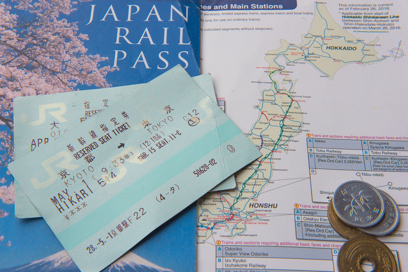 Japan Rail Pass and Japanese cash. Editorial credit: oatautta / Shutterstock.com