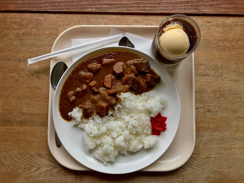 A substantial plate of curry rice, coffee and ice cream.