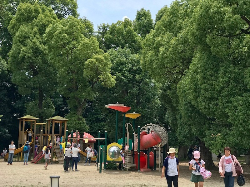 A playground near the southern entrance, full of parents and their children.