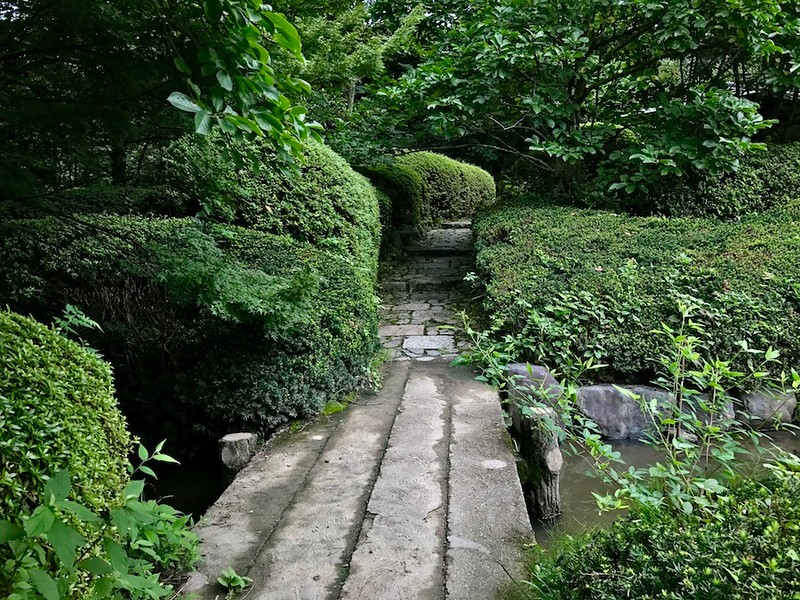 A secluded, lush green path in the gardens we stumbled across on our visit.