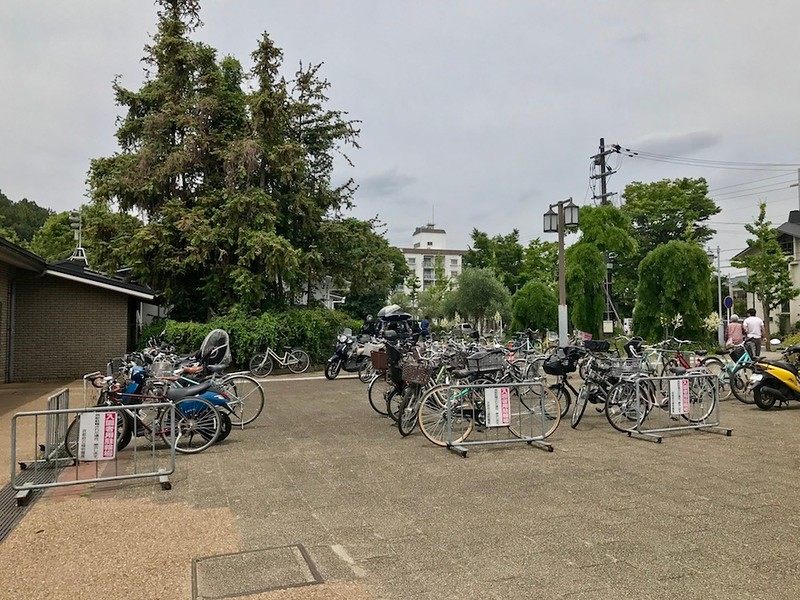 Parking space for both bicycles and motorcycles at the Kitayama entrance.