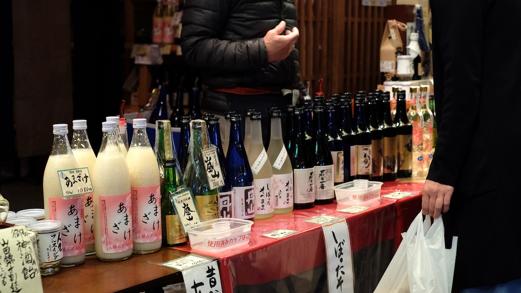 Sampling sake at Nishiki Market.