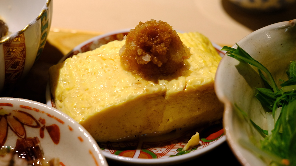 Tamagoyaki with soy-spiked grated radish.