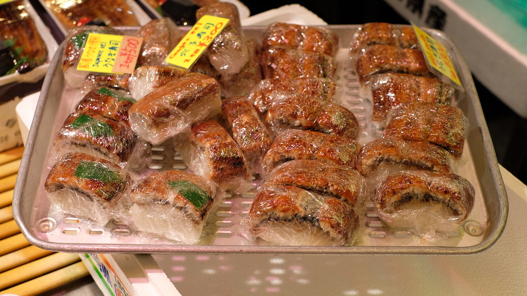 Individually-wrapped unagi sushi.