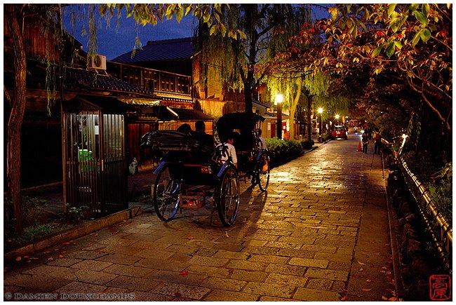 A couple of rickshaws rolling through Gion Shirakawa at night image copyright Damien Douxchamps