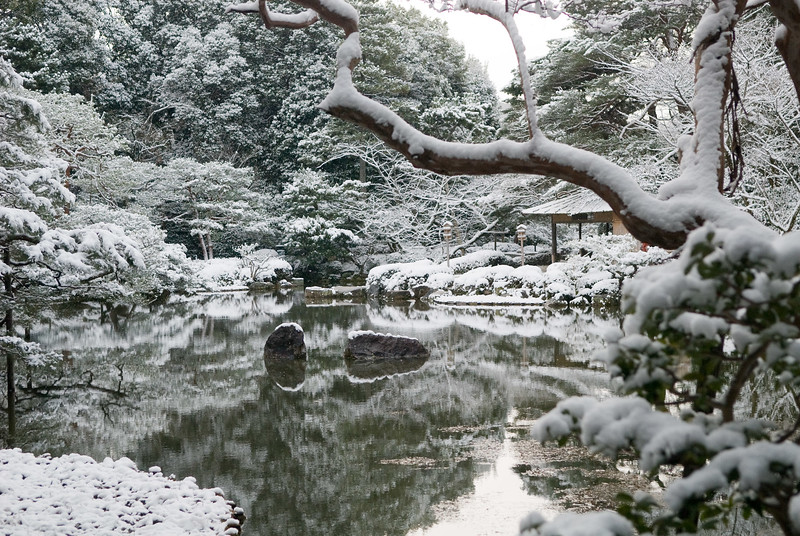 Snow-covered rocks at Heian-jingu Shrine image copyright Jeffrey Friedl