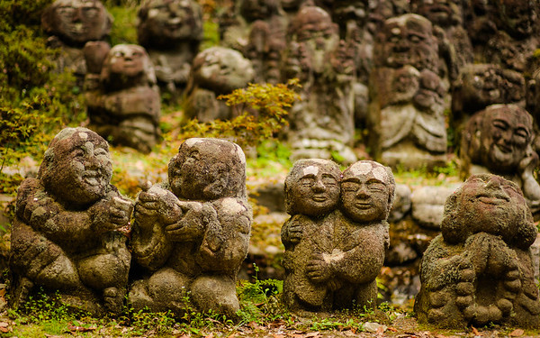 Jizo figures having a grand time in the moss image copyright Jeffrey Friedl