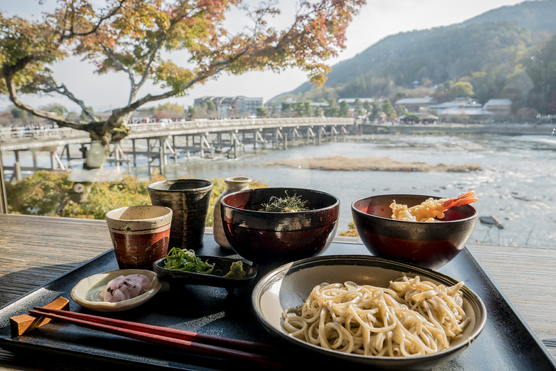 Soba set overlooking Togetsu-kyo Bridge in Arashiyama. Editorial credit: toiwoody / Shutterstock.com
