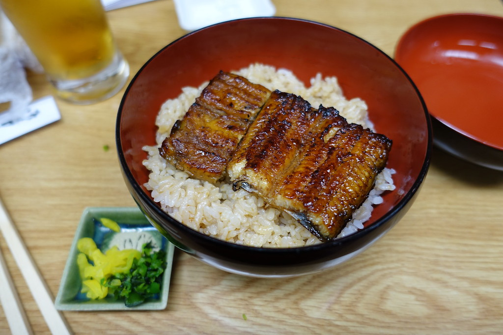 Unagi with rice and beer in Kyoto. Editorial credit: ocelot'slens / Shutterstock.com