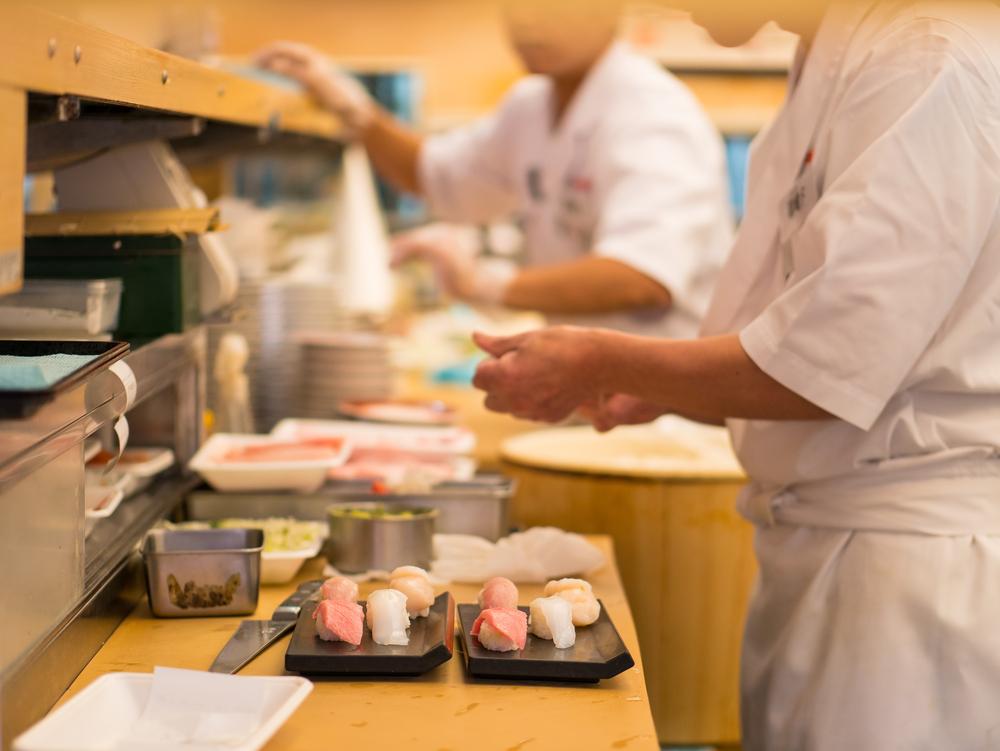 Sushi chefs in action. Editorial credit: Benoist / Shutterstock.com
