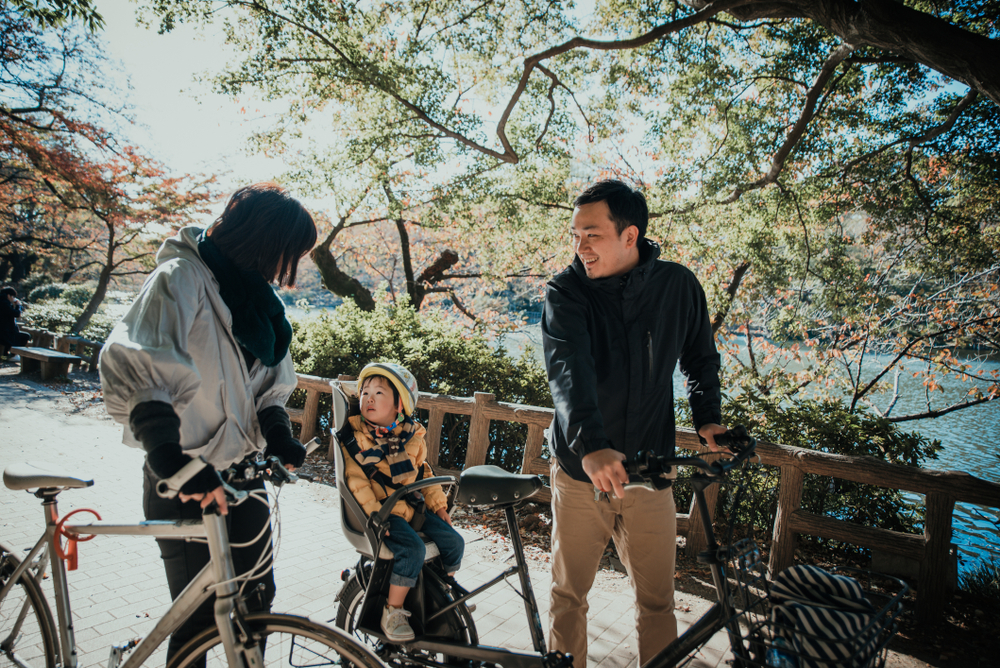 Japanese family cycling in Kyoto. Editorial credit: oneinchpunch / Shutterstock.com