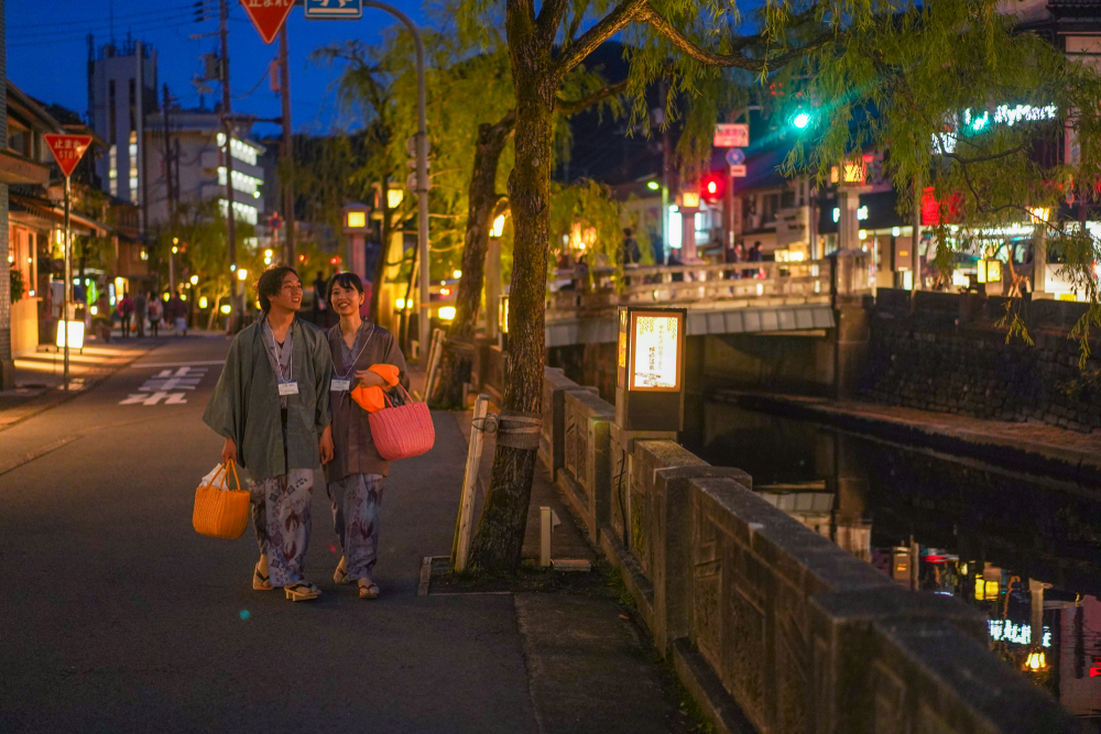 Couple strolling at Kinosaki Onsen. Editorial credit: Rei Imagine / Shutterstock.com