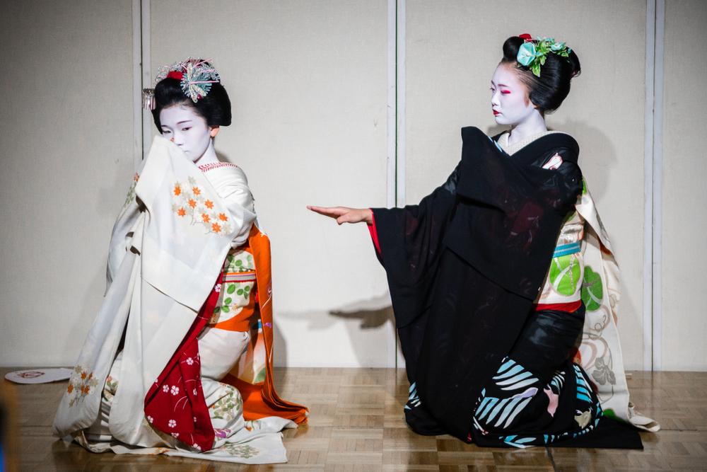 Two Kyoto maiko (apprentice geisha). Editorial credit: Jon Chica / Shutterstock.com