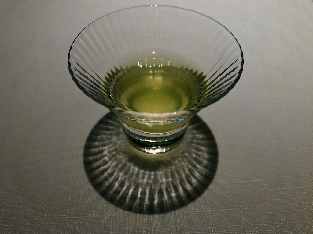 A small, delicate glass of green tea.