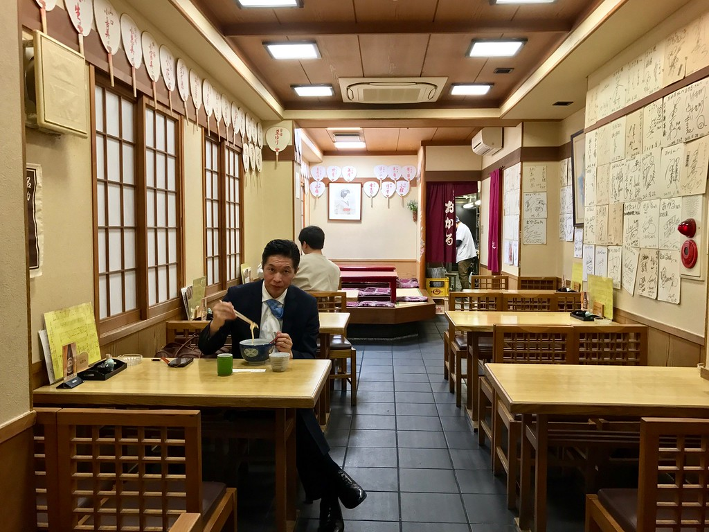 The quiet interior of Okaru on a weekday evening.