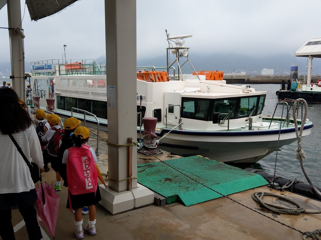 Boarding the small passenger boat.
