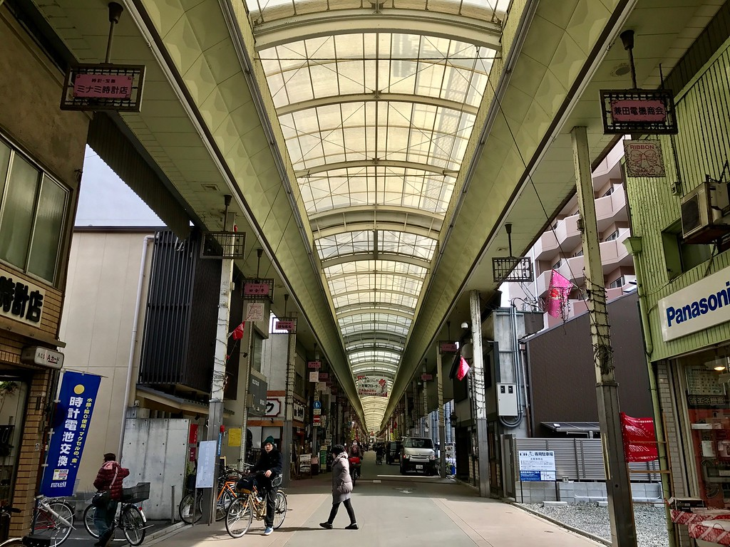 Plenty of space for pedestrians in this arcade.